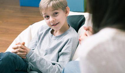 Happy boy having hypnotherapy